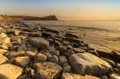 Rocky Dorset Coastline at sunset — Stock Photo