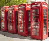 Four red telephone boxes in London — Stok fotoğraf