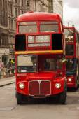 Old London bus being followed by a newer model — Stock Photo