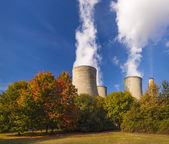 Cooling towers spew clouds into the atmosphere — Stock Photo