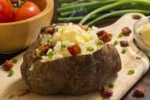 Potatoe with toppings — Stock Photo