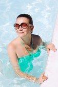 Beautiful sports woman in water — Stock Photo