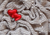 Knitted wool, red heart, pearl, valentine — Stockfoto