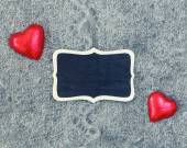 Wool texture hearts wooden plate — Stock Photo