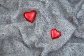 Grey wool, red hearts, Valentine — Stock Photo