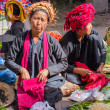 Three unidentified women in traditional dress sells vegetables at market of Inn Dain Khone Village, on Inle Lake. — Stock Photo #73207367