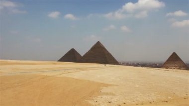 Pyramids on the background of Cairo. Approximation — Stock Video