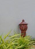 Asian style pottery garden lamp  — Stock Photo