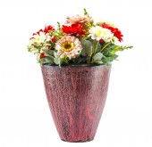 Colorfull plastic flowers in potery jar — Stock Photo