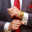 Businessman with red tie and golden accessories — Stock Photo #52401567