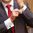 Businessman with red tie and golden accessories — Stock Photo #78598462