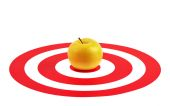 Apple in the center of red target — Stock Photo