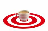 Coffee cup in the center of red target — Stock Photo