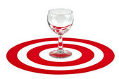 Wine glass in the center of red target — Stock Photo