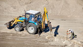Construction tractor in action — Stock Photo