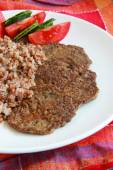 Chicken liver cakes with buckwheat and vegetables. — Stock Photo