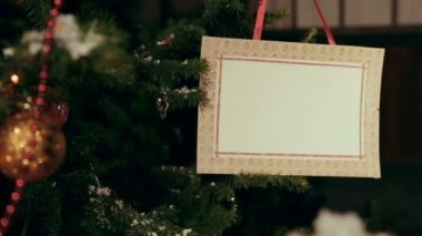 Christmas tree with postcard-placeholder on it — Vídeo de stock