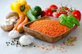 Red lentil and different vegetables — Stock Photo