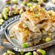 Turkish pistachio pastry dessert  baklava with green pistachios — Stock Photo #54222313