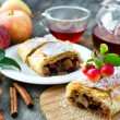 Baked strudel with apples on a plate — Stock Photo #54222929