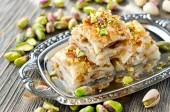 Turkish pistachio pastry dessert  baklava with green pistachios — Stock Photo