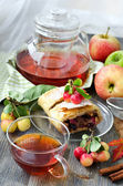 Cup of tea with fruitcake strudel — Stock Photo
