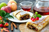 Baked strudel with apples on a plate — Stock Photo