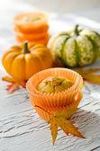 Orange pumpkin muffins with autumn leaves — Stock Photo