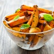 Sweet potato baked in a bowl with herbs — Stock Photo #54745423