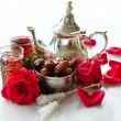 Traditional arabic tea with metal teapot and dates — Stock Photo #63669149