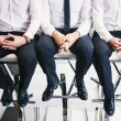 Three men in white shirts and trousers — Stock Photo #56581319