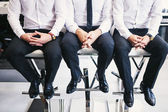 Three men in white shirts and trousers — Stock Photo