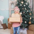 Little girl with new year gifts — Stock Photo #58793509