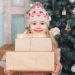 Beauty little girl with new year gifts — Stock Photo #58793897