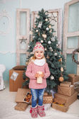 Many gifts and little girl — Stock Photo