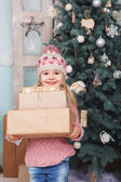 Girl with new yaer gifts — Stock Photo