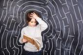 Boy trying to solve the maze — Stock Photo