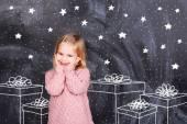 Girl enjoys gifts — Stock Photo