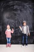 Beautiful children on a gray background — Stock Photo