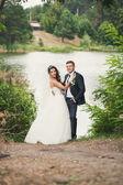Newlyweds near the river — Stock Photo
