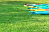 Canoeing the many colorful arranged on the lawn. From water to dry — Stock Photo