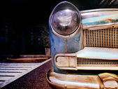 Detail of the front headlight of an old car in vintage retro image. — Stock Photo