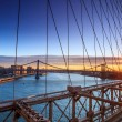 Lower Manhattan through Brooklyn Bridge at sunset, New York City — Stock Photo #71957171