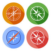 Vector icons depicting four different compasses — Stock Vector