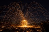 Beautiful sparkle sparklers in a circle on a black background — Stock Photo