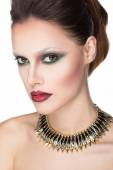Glamour portrait of beautiful woman model with creativ makeup and original hairstyle. Fashion shiny highlighter on skin, sexy red lips make-up and dark eyebrows — Stock Photo