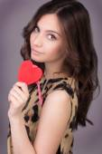 Love and valentines day woman holding heart smiling cute and adorable. Valentine's Day. Portrait of Beautiful gorgeous smiling woman with glamour bright makeup and red heart in hand — Stock Photo