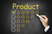 Hand writing product golden rating stars on chalkboard — Stock Photo