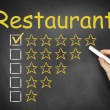 Hand writing restaurant on chalkboard ranking — Stock Photo #54655225