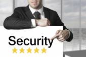Businessman pointing on sign security — Stock Photo